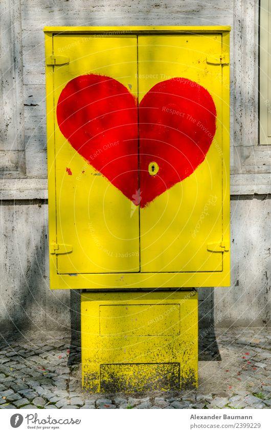 yellow distribution box with red heart-shaped sign Telekommunikation Informationstechnologie Internet Energiewirtschaft Mauer Wand Verteiler Zeichen Herz gelb