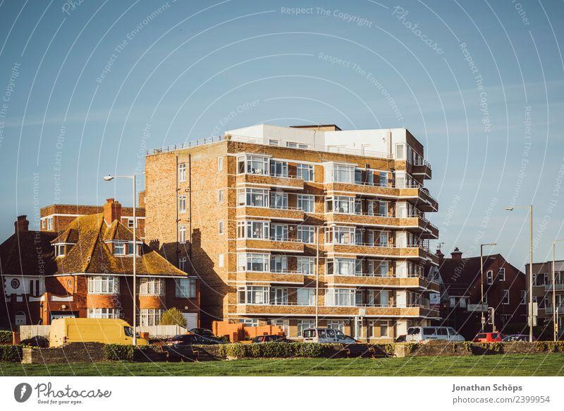 Häuserfassade in Brighton, England Stadt Haus Bauwerk Gebäude Architektur Fassade Billig Wohnung Großbritannien Sonnenstrahlen Außenaufnahme Wohnsiedlung