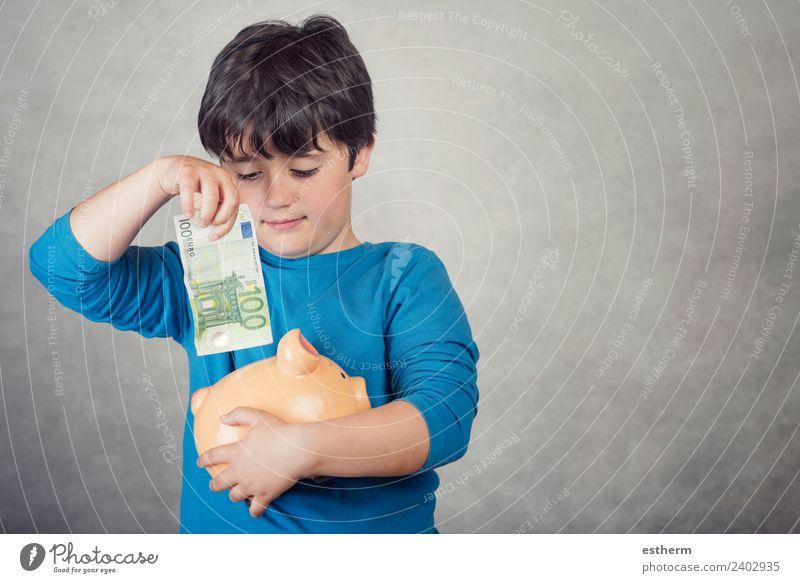 Kindersparen in einer Sparbüchse auf grauem Hintergrund Lifestyle kaufen Reichtum Freude Glück Geld Mensch maskulin Kleinkind Kindheit 1 8-13 Jahre Eurozeichen