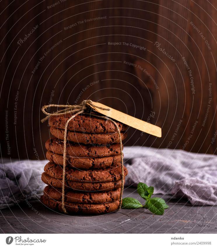 runde Schokoladenplätzchen Dessert Süßwaren Ernährung Seil Essen lecker braun schwarz Keks Hintergrund Lebensmittel Stapel süß backen Biskuit Feiertag
