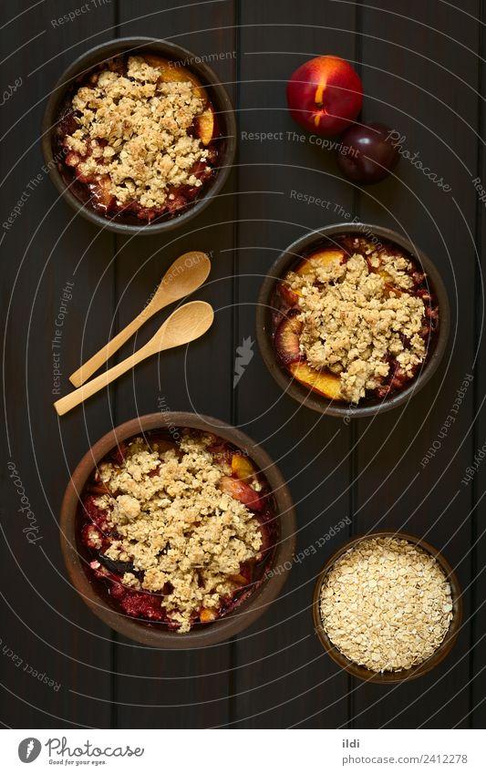 Gebackene Pflaume und Nektarinenstreusel Frucht Dessert süß Pfirsich bröckeln knusprig Schuster Lebensmittel Speise Mahlzeit Snack Kruste gebastelt Hafer