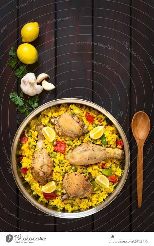 Spanische Hühner-Paella Fleisch Gemüse frisch Hähnchen Federvieh Oberschenkel Reis Speise Mahlzeit Lebensmittel Valencianer mediterran Essen zubereiten Paprika