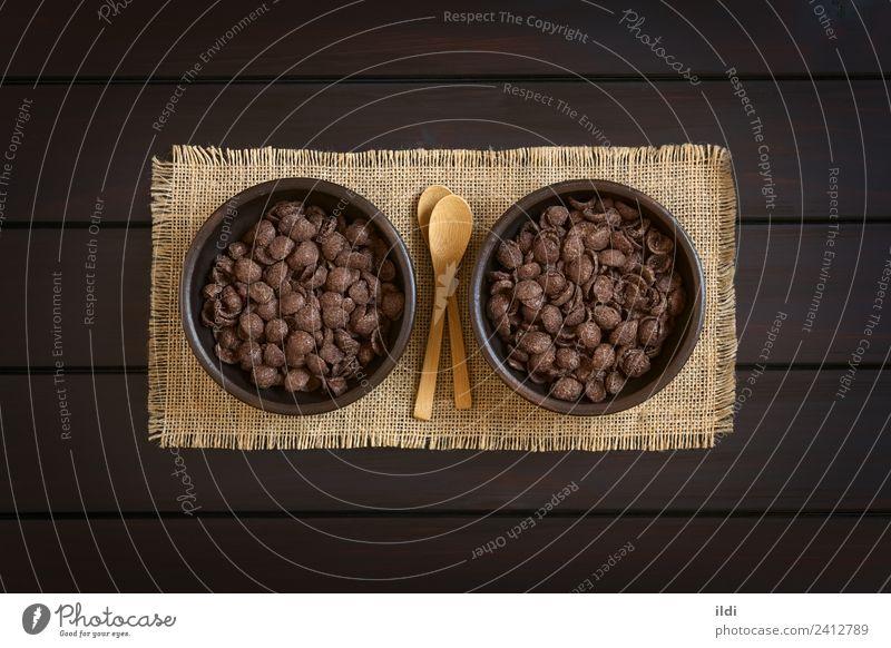 Schokolade Maisflocken Frühstück Getreide süß Lebensmittel Schuppen Flocken gesüßt Müsli Mahlzeit Snack bearbeitet knusprig knackig Holz rustikal Overhead