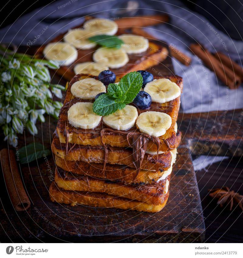 Brotscheiben mit Schokolade Frucht Dessert Süßwaren Ernährung Frühstück Blume Holz Essen frisch lecker oben Tradition Zuprosten Französisch Banane Hintergrund