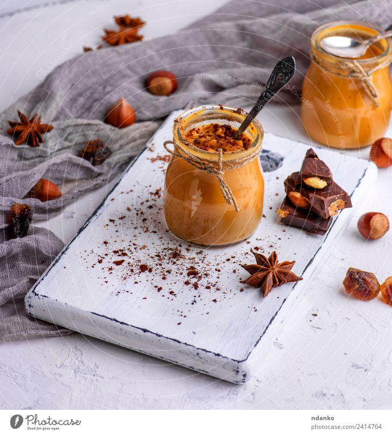 Karamell-Dessert Toffee Süßwaren Löffel Tisch Holz lecker oben braun Saucen Hintergrund Glas Gießen süß Zucker gebastelt Lebensmittel Klebrig Sirup