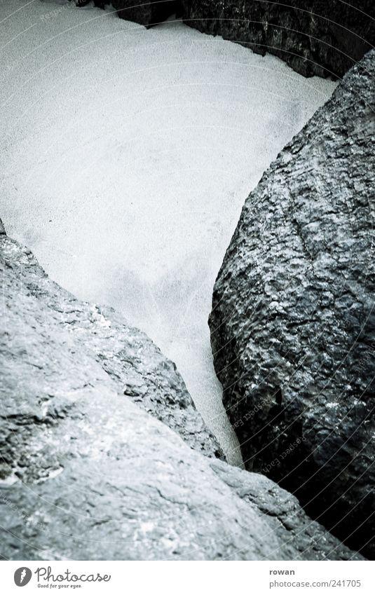 steinig Natur Landschaft Felsen Küste grau hart rund ruhig Formation Strukturen & Formen Sand Strand Stein Kontrast Schwarzweißfoto Außenaufnahme Menschenleer