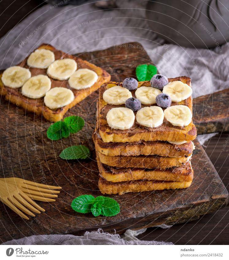 Französischer Toast auf das Frühstück Frucht Brot Dessert Süßwaren Ernährung Gabel Holz Essen frisch lecker oben Tradition Zuprosten Banane Schokolade