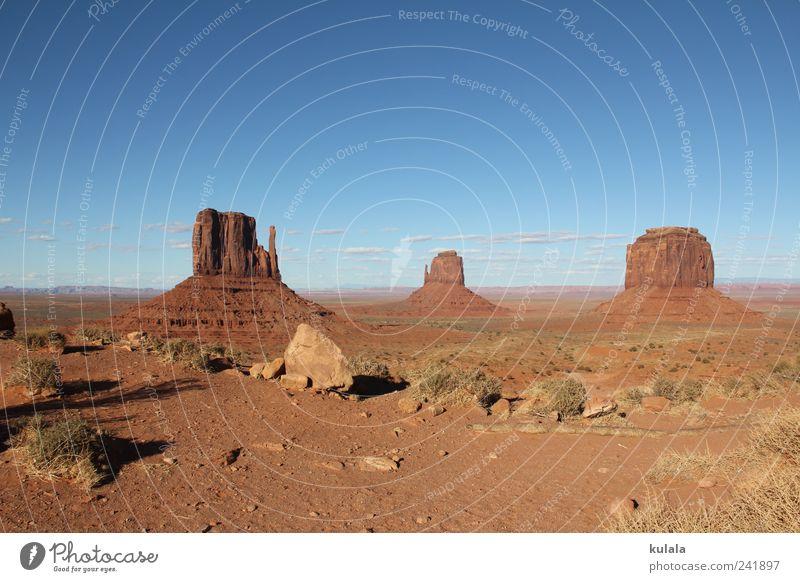 Monument Valley Ferne Natur Landschaft Erde Wolkenloser Himmel Dürre Felsen Berge u. Gebirge Schlucht Wüste blau braun Fernweh einzigartig Horizont Stimmung