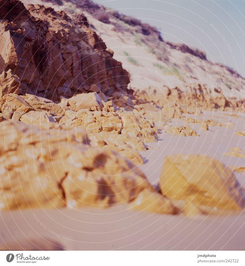 Felsküste Natur Ferien & Urlaub & Reisen Meer ruhig Freude Ferne Strand natürlich Küste Stein Sand Felsen Zufriedenheit Tourismus Kraft Ausflug