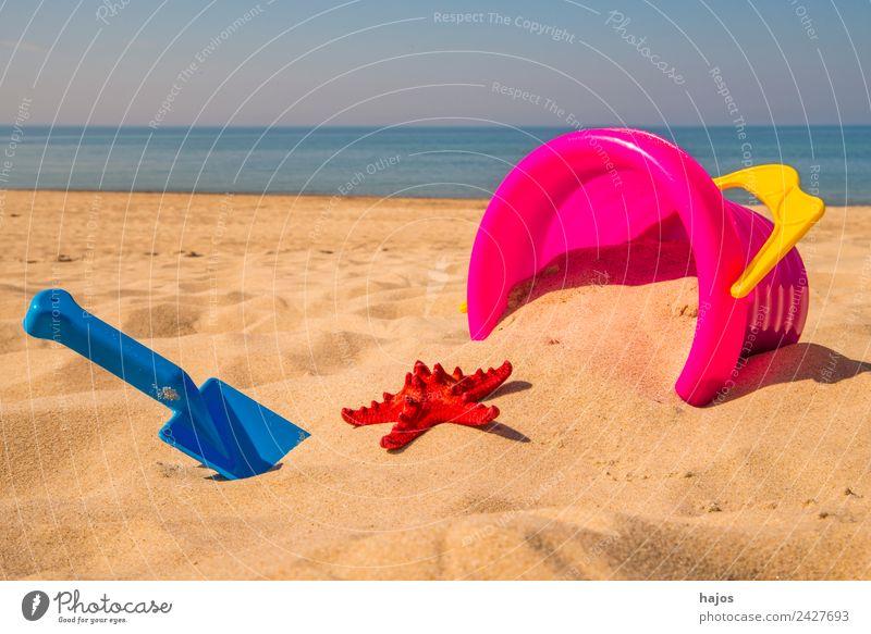 Sandeleimer mit Schaufel und Seestern am Strand Freude Erholung Freizeit & Hobby Spielen Ferien & Urlaub & Reisen Sommer Kind heiß hell blau gelb rosa rot Meer