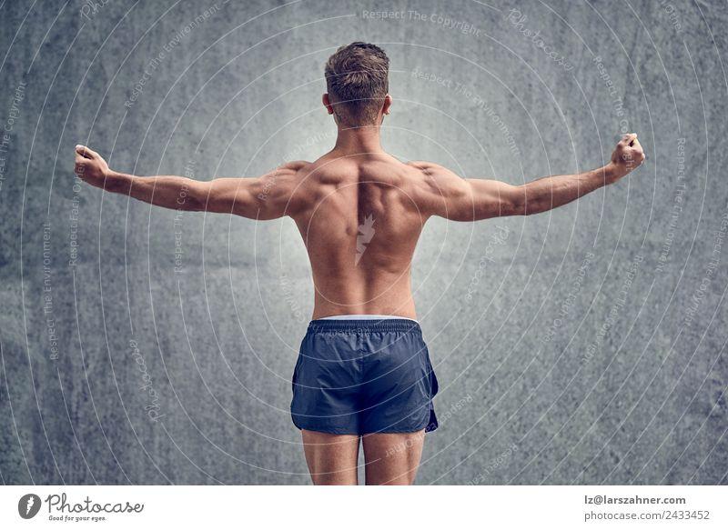 Junger männlicher Bodybuilder posierend Körper Sport Mann Erwachsene 18-30 Jahre Jugendliche Fitness muskulös stark Kraft Rücken Körperhaltung Hintergrund