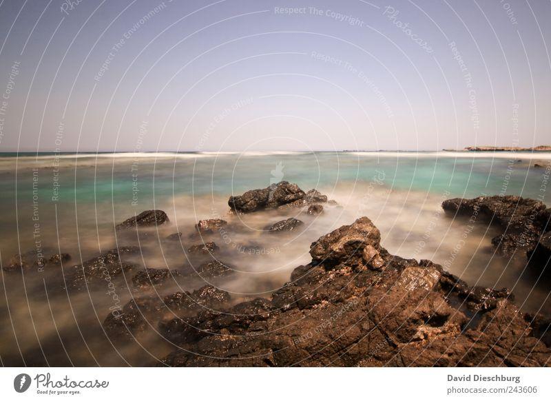Kretische Küste II blau Wasser Ferien & Urlaub & Reisen grün Sommer Meer Einsamkeit ruhig Erholung Landschaft Stein Horizont braun Felsen Wellen