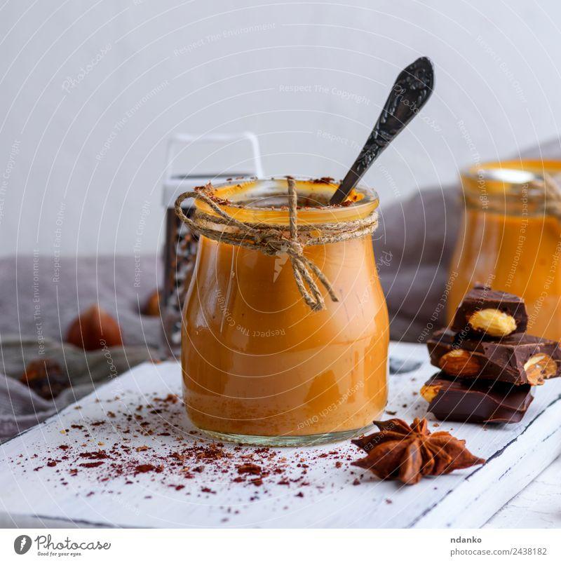 Karamell-Dessert Toffee Süßwaren Löffel Tisch Holz Essen lecker braun Saucen Hintergrund Glas Gießen süß Zucker gebastelt Lebensmittel Klebrig Sirup