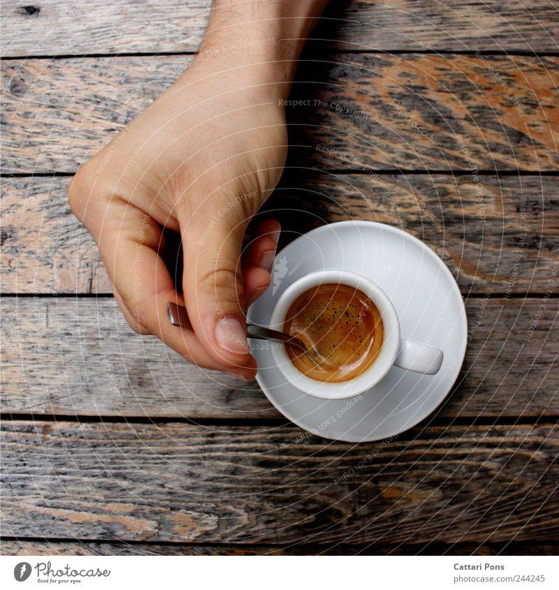 Espresso Heißgetränk Kaffee Tasse Löffel elegant trinken Hand machen Flüssigkeit gut heiß lecker genießen Holz Tisch rühren mischen Koffein Wachsamkeit bitter