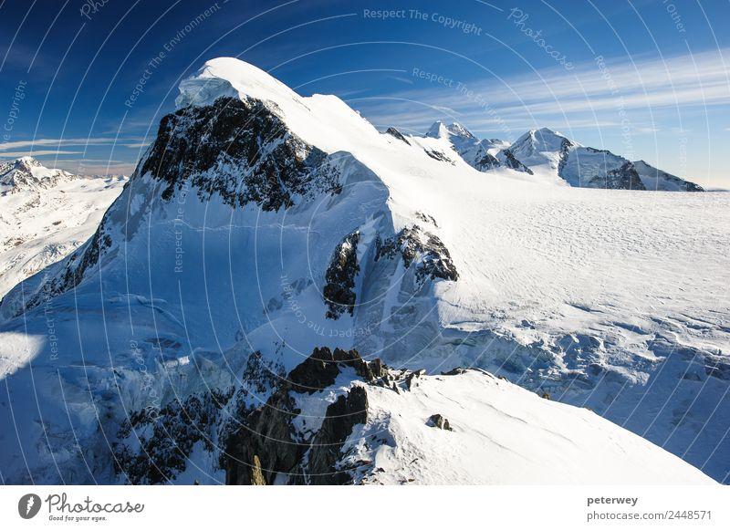 Breithorn mountain peak. View from kl. Matterhorn, Zermatt Ausflug Winter Natur Schnee Alpen Berge u. Gebirge wandern anstrengen alpin alps blue castor