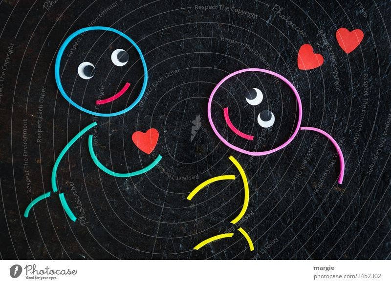 Gummiwürmer: Liebeserklärung maskulin feminin Mädchen Junge Auge 2 Mensch mehrfarbig rot schwarz Gefühle Vorfreude Vertrauen Einigkeit Freundschaft Zusammensein