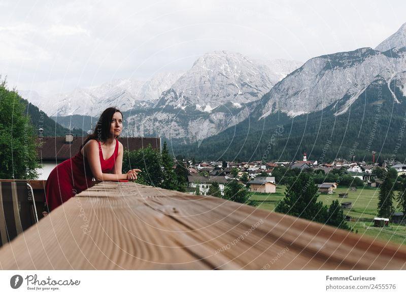 Young woman enjoying the view of the alps from a balcony feminin Junge Frau Jugendliche Erwachsene 1 Mensch 18-30 Jahre 30-45 Jahre Natur Erholung Balkon Kleid