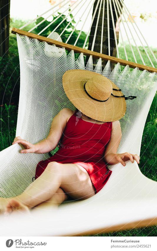 Young woman relaxing in a hammok feminin Junge Frau Jugendliche Erwachsene 1 Mensch 18-30 Jahre 30-45 Jahre Erholung Sonnenhut Hängematte Garten Kleid Sommer