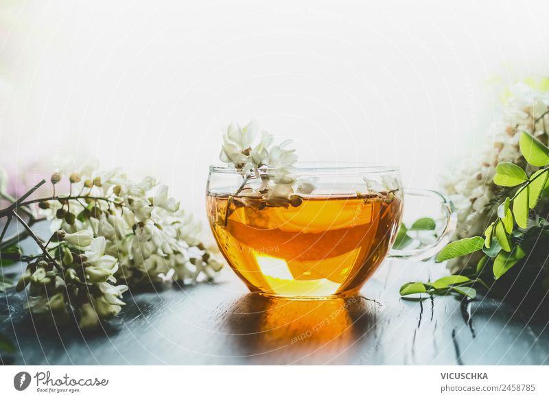 Akazien Kräutertee in Glastasse Lebensmittel Getränk trinken Heißgetränk Tee Stil Design Gesundheit Alternativmedizin Gesunde Ernährung Natur Pflanze gelb