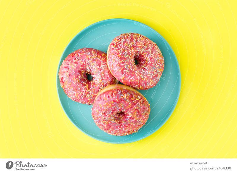 Rosa gefrosteter Donut Brötchen Dessert Süßwaren gut süß gelb rosa Krapfen Lebensmittel Bonbon mehrfarbig Kuchen Backwaren Zuckerguß Golfloch Snack