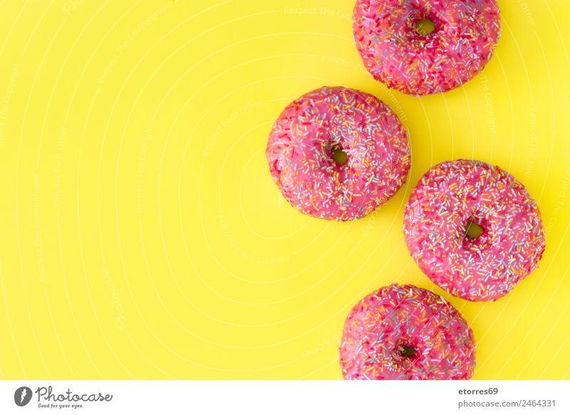 Rosa gefrosteter Donut Lebensmittel Brötchen Dessert Süßwaren Krapfen Frühstück gelb rosa Bonbon mehrfarbig Kuchen Backwaren Zuckerguß Golfloch Snack