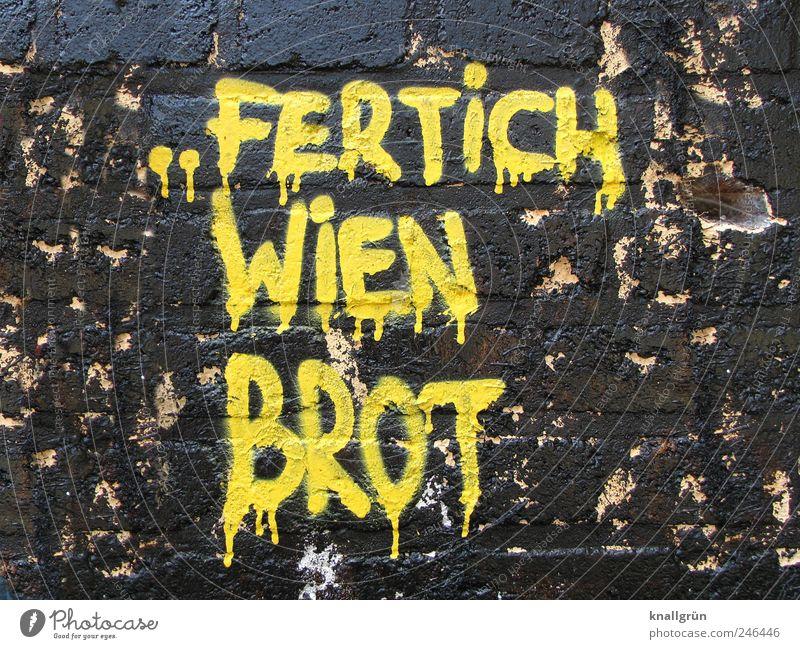 FERTICH WIEN BROT gelb Wand Graffiti Mauer Kunst lustig braun dreckig Fassade Schriftzeichen Coolness Kommunizieren Kultur Kreativität trendy Kunstwerk