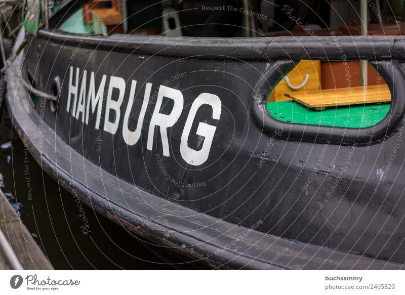 Nahaufnahme von einem Schiff mit dem Namen der Hansestadt Hamburg Hamburger Hafen Schifffahrt Schiffsrumpf transport Handel typisch reisen Stadt Urlaub