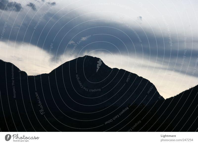 Touch from above Himmel Natur blau Ferien & Urlaub & Reisen Ferne Berge u. Gebirge Gefühle Landschaft grau Stein Stimmung Luft Erde Felsen Urelemente Hügel