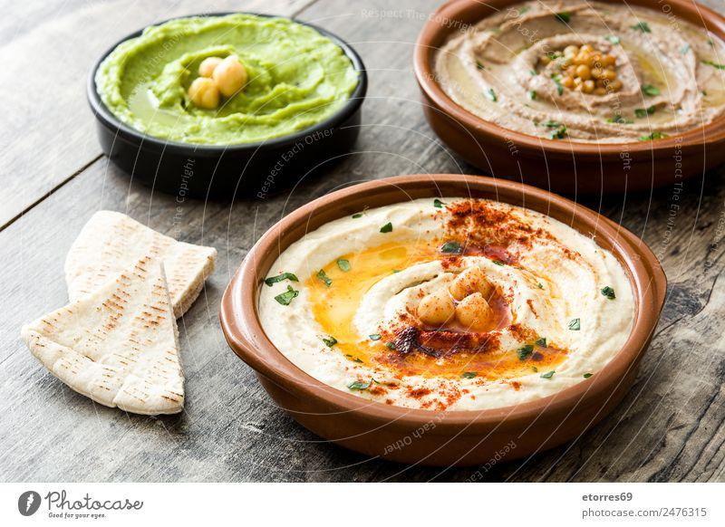 Verschiedene Hummuschalen Lebensmittel Gemüse Getreide Ernährung Bioprodukte Vegetarische Ernährung Schalen & Schüsseln frisch Gesundheit braun grün Linsen