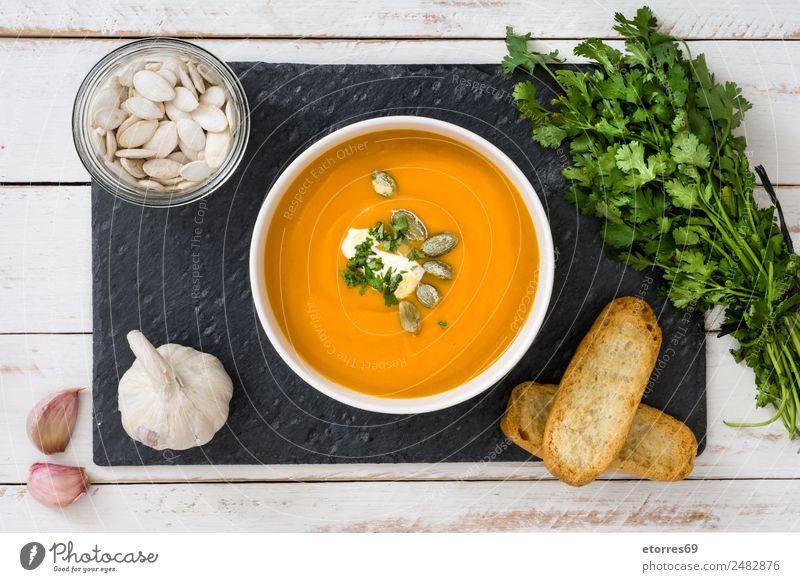 Kürbissuppe Lebensmittel Gemüse Brot Suppe Eintopf Mittagessen Schalen & Schüsseln Erntedankfest gut orange Gesunde Ernährung Zutaten Knoblauch Petersilie Samen