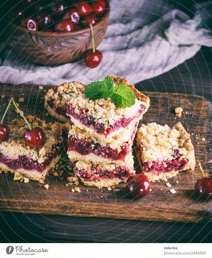 Haufen gebackener Kuchen mit Kirsche Frucht Dessert Süßwaren Vegetarische Ernährung Tisch Holz frisch lecker braun gelb gold grün rot schwarz bröckeln Pasteten