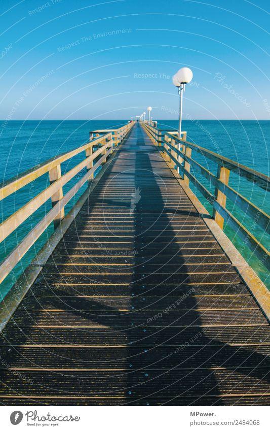 seebrücke Landschaft Schönes Wetter Hafenstadt Bauwerk Wahrzeichen blau Seebrücke Ostsee Meer Wasser Wolkenloser Himmel türkis Laterne Menschenleer Steg