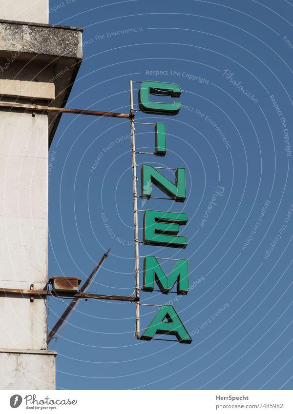 Leuchtschrift Stadtzentrum Bauwerk Gebäude Schriftzeichen Schilder & Markierungen alt ästhetisch retro grün Leuchtreklame Kino Fassade Farbfoto Außenaufnahme