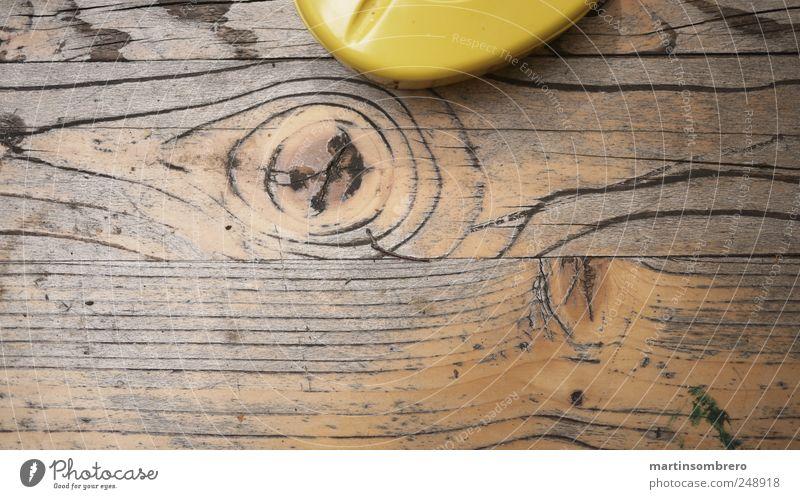 Holz und Plastik alt gelb grau Stimmung braun glänzend neu Kunststoff Tischplatte