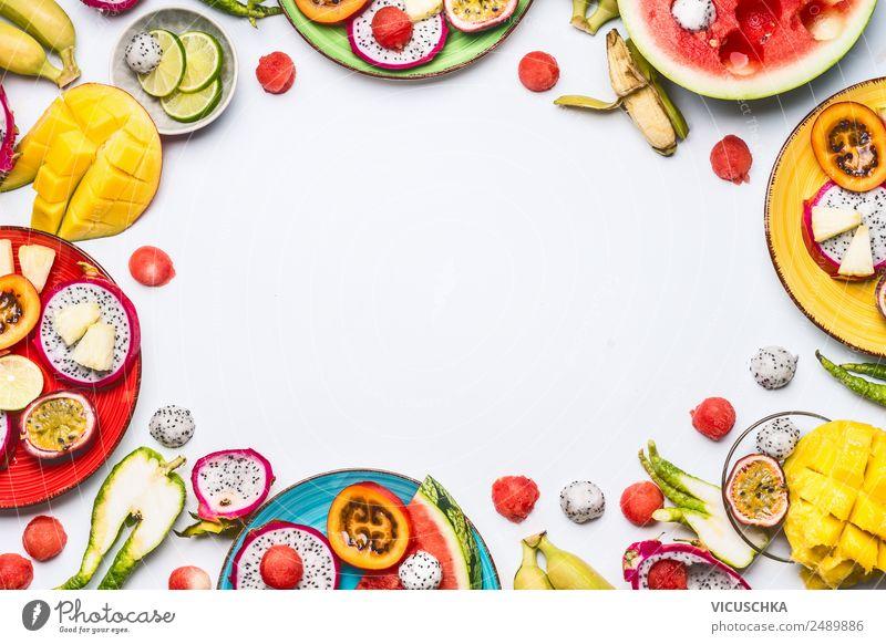 Exotische Obst und Früchte geschnitten auf Teller Lebensmittel Frucht Apfel Orange Ernährung Bioprodukte Getränk Saft kaufen Stil Design Sommer Gesundheit