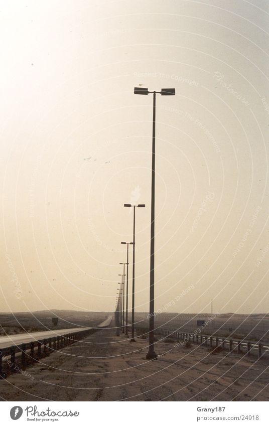 Straight away!!! Lampe Laterne Werbefachmann Plakat Panorama (Aussicht) Ferien & Urlaub & Reisen Verkehr Linie Autobahn Wüste Sand Sonne Strommast Werbemittel