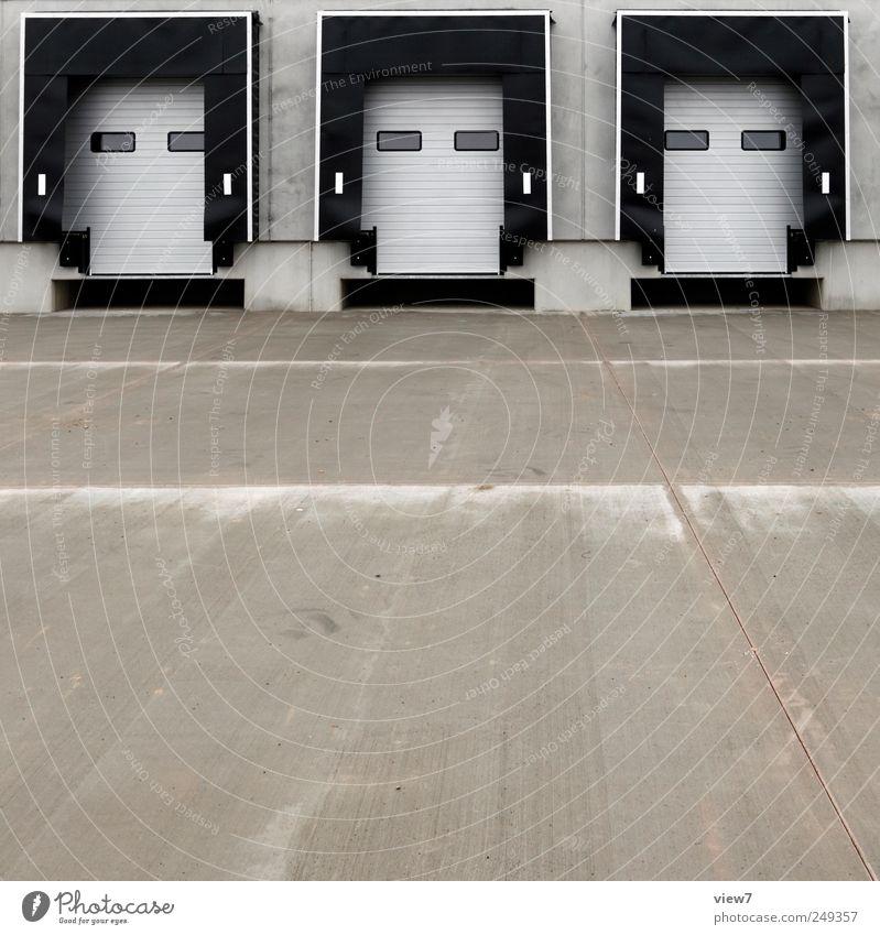 Konsum Industrieanlage Fabrik Architektur Mauer Wand Fassade Güterverkehr & Logistik Stein Beton Linie Streifen authentisch kalt modern neu viele grau Ordnung