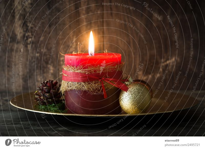 Weihnachten & Advent rot Erholung Winter Wärme Feste & Feiern Dekoration & Verzierung Feuer Kerze Jahreszeiten Gelassenheit Holztisch Ornament