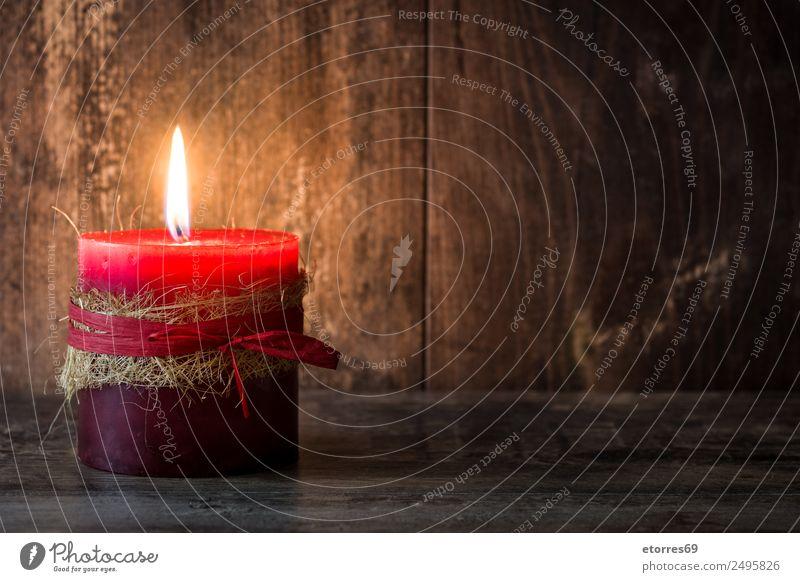 Rote Kerze Weihnachten & Advent rot Gelassenheit Windstille Dekoration & Verzierung Ornament Feuer Holztisch Feste & Feiern Jahreszeiten Winter Erholung Wärme