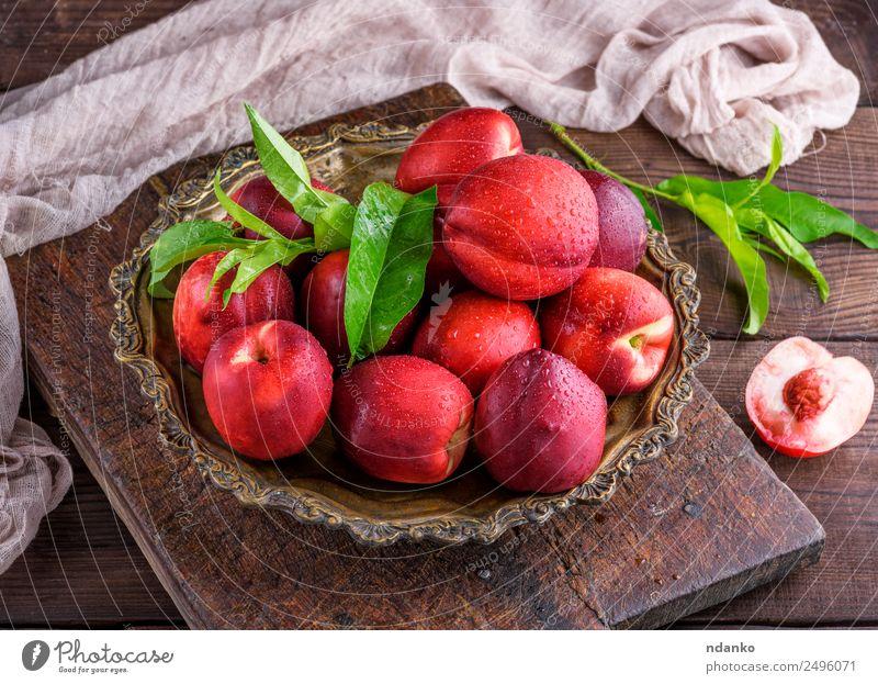 rote reife Pfirsiche Frucht Dessert Ernährung Teller Schalen & Schüsseln Sommer Tisch Blatt Holz Essen frisch oben saftig braun grün Nektarine Hintergrund