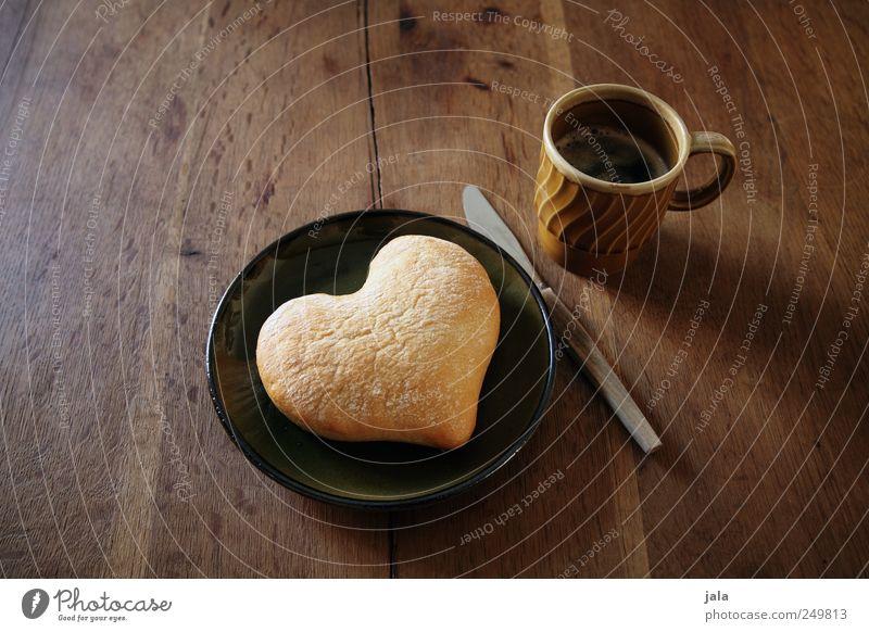 herzel Lebensmittel Brötchen Frühstück Getränk Heißgetränk Kaffee Teller Tasse Messer lecker braun grün Freude Lebensfreude Sympathie Freundschaft Liebe