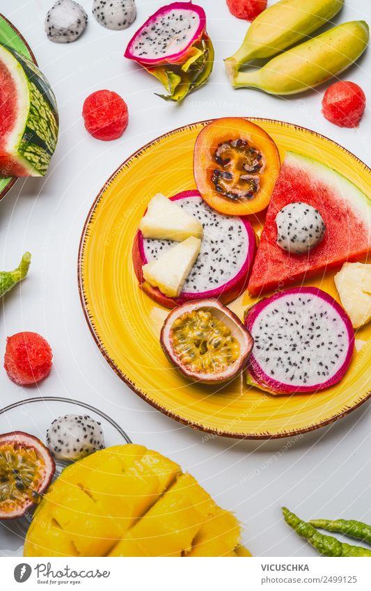 Exotische Früchte Plate Lebensmittel Frucht Dessert Ernährung Bioprodukte Vegetarische Ernährung Diät Teller Lifestyle Stil exotisch Gesunde Ernährung gelb