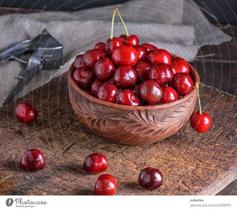 rote reife frische Kirsche Frucht Vegetarische Ernährung Schalen & Schüsseln Tisch Natur Holz Essen saftig braun Hintergrund Lebensmittel Gesundheit süß