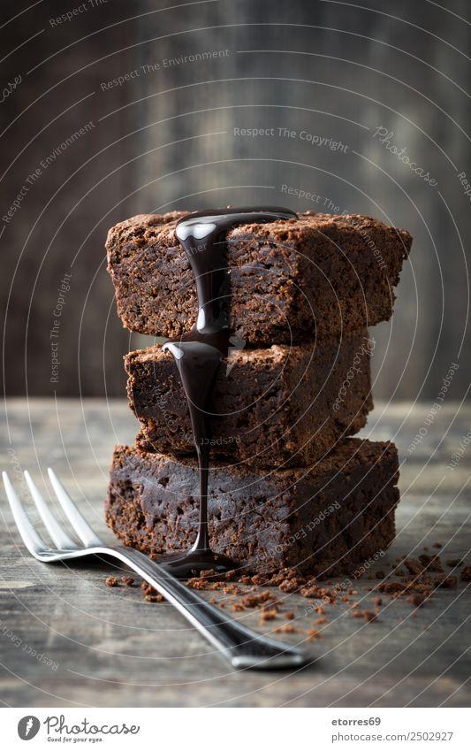 Schokoladenbrownie Lebensmittel Kuchen Dessert Süßwaren Frühstück frisch gut süß braun Brownie Snack Backwaren Gabel Teile u. Stücke liquide lecker Zucker