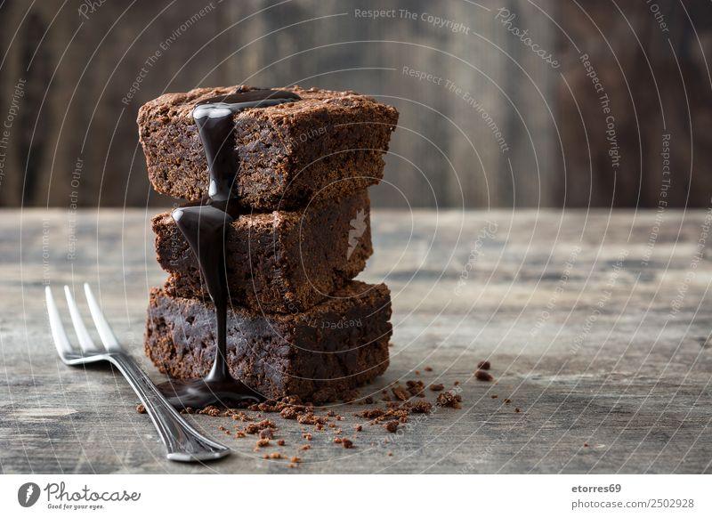 Schokoladenbrownie-Portionen auf Holzuntergrund Lebensmittel Kuchen Dessert Süßwaren Ernährung Frühstück Mittagessen Bioprodukte Vegetarische Ernährung Gabel