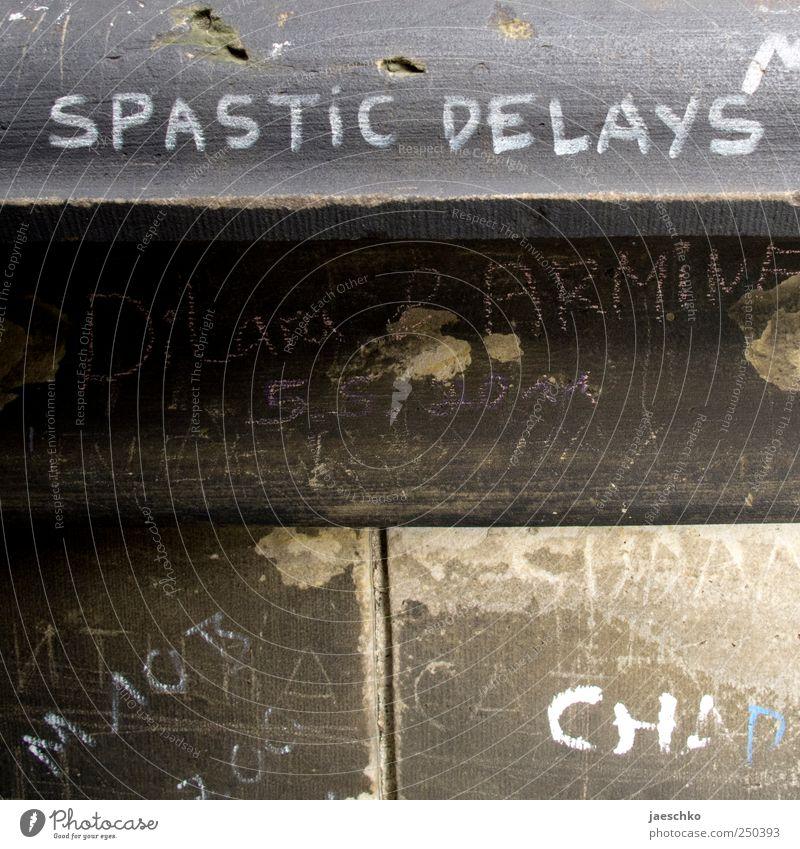 Spastische Verzögerungen Wand Graffiti Stein Mauer Beton Schriftzeichen Zeichen trashig skurril rebellisch Schmiererei Kritzelei