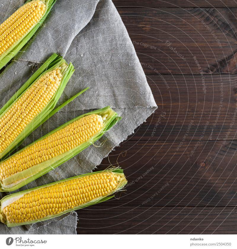 frische reife Maiskolben Lebensmittel Gemüse Ernährung Vegetarische Ernährung Tisch Natur Pflanze Blatt Holz Essen natürlich oben braun gelb gold grau Kolben