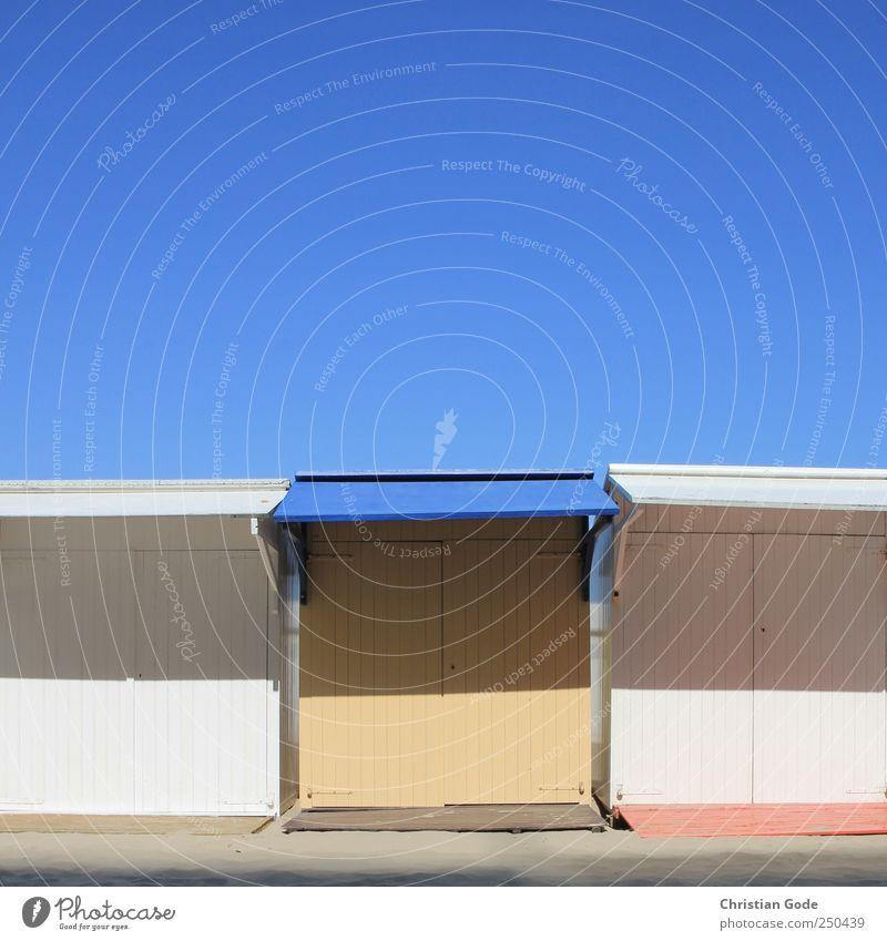 Strandhütten blau rot Sommer Ferien & Urlaub & Reisen Meer Haus Ferne gelb Architektur Sand Gebäude Ausflug Schwimmen & Baden Tourismus Insel