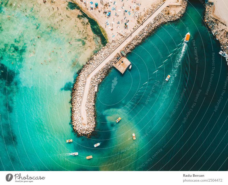 Luftaufnahme des Betonpiers auf türkisfarbenem Wasser am Schwarzen Meer Felsen Strand Buhne Hintergrundbild blau Stein