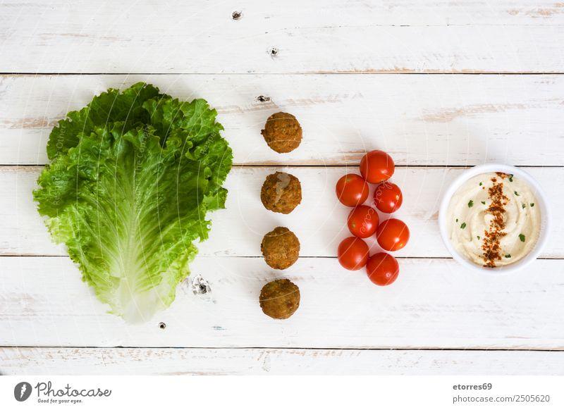 Vegetarische Falafel und Zutaten Lebensmittel Gemüse Getreide Ernährung Bioprodukte Vegetarische Ernährung Asiatische Küche gut braun grün rot Kichererbsen